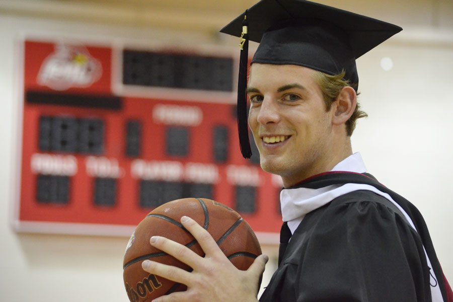 Graduate scores on the court and in class