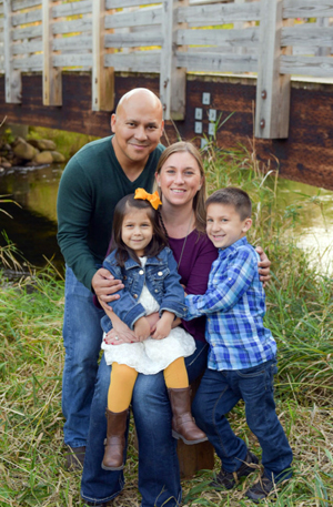 George Diaz poses with his family: daughter, Nora; wife, Heather; and son, Sam.