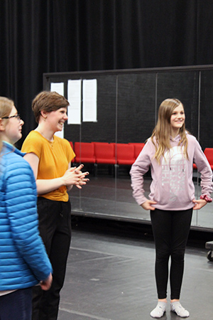 Ahnika Lexvold provides instruction to Winona area students Lillian Bublitz and Anastasia Shutz.