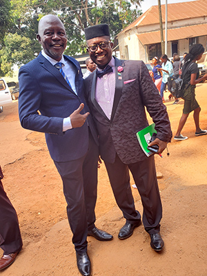 Sylvester Amara Lamin with Patrick Walker, head of the Department of Sociology and Social Work at Fourah Bay College, on the college campus in Freetown, Sierra Leone.