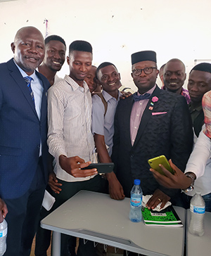 On the day of his lecture at Fourah Bay College, Sylvester Amara Lamin took time for photos with students from the college.
