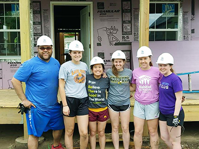Carol Dao poses with other members of the Habitat for Humanity Club, where she served as the president this past school year. From left: Nazeer Zerka, Wellness Center counselor, and students Daynalyn Jostock, Dao, Abigail Mazurek, Rebecca Behm, and Samantha Henning.