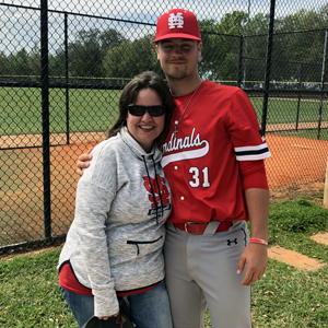 This is a photo of Joanne Schneider and her son, Sam, who is a first-year catcher on the Saint Mary's baseball team.