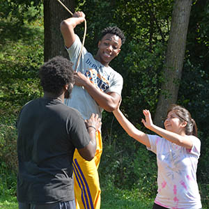 Photo of Kareem Anthony-Bello at a recent FGI Retreat with his classmates Stanley Wright and Crystal Chavez.