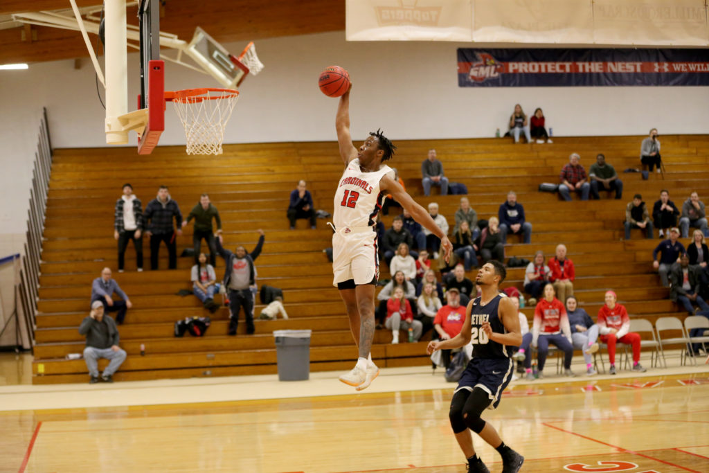 This is a photo of Kareem Anthony-Bello extending his arm in preparation for a slam dunk against Bethel.