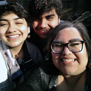This is a photo of Carla Guillen with her brother, Juan-Pablo, and her sister, Daniela, who works on the Twin Cities Campus as an administrative assistant.