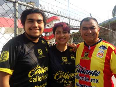 This is a photo of Carla Guillen and her brother and father at a soccer game in Mexico.