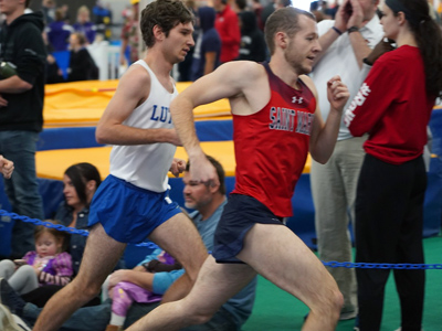 This is a photo of Jacob Tschida competing on the men's track team.